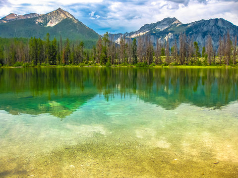 Spectacular landscape of Sawtooth National Forest which is reflected in Alice Lake, heart of Idaho, United States.