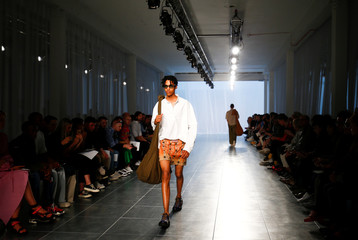 A model presents a creation at the Qasimi show at London Fashion Week Men's, in London