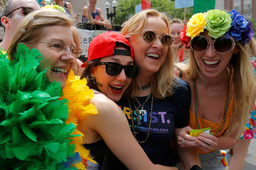 U.S. Senator Elizabeth Warren and musician Melissa Etheridge pose for a photograph while marching in Boston's 48th Pride Parade in Boston