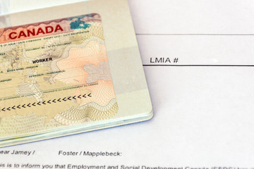 Canadian working visa and LMIA, Labour Market Impact Assessment paper document.Immigration to Canada concept.