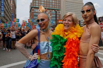 U.S. Senator Elizabeth Warren poses for a photograph while marching in Boston's 48th Pride Parade in Boston