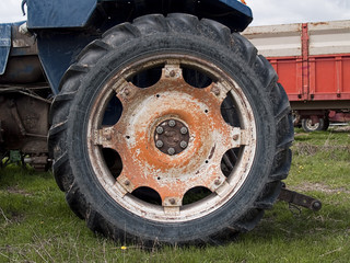 Orange old truck wheel detail with oxide
