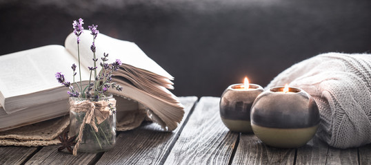 still life a book and a candle on a wooden table