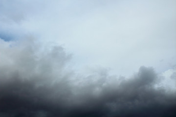 The blue sky and dark storm clouds. Background. Landscape.