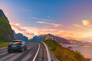 Car on road in Norway, Europe. Sunset travel