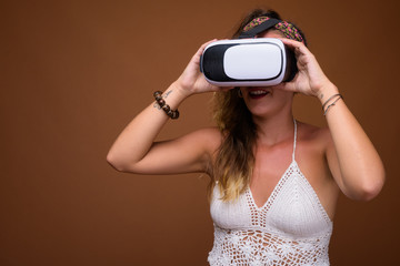 Woman using VR glasses for virtual reality experience