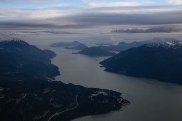 Aerial view of Howe Sound during a cloudy evening. Taken near Squamish, North of Vancouver, British Columbia, Canada.