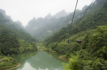 The longest cableway in the world, landscape view with the lake, mountains, green forest and mist - Tianmen Mountain, The Heaven's Gate at Zhangjiagie, Hunan Province, China, Asia