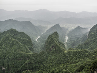 Tianmen Mountain Known as The Heaven's Gate surrounded by the green forest and mist at Zhangjiagie, Hunan Province, China, Asia