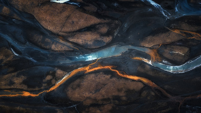 Aerial photo of mix color of stream in to river