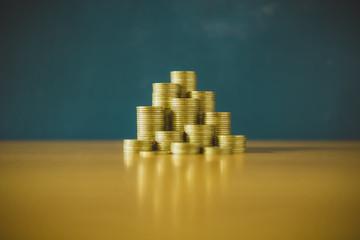gold coin stack Blackboard background