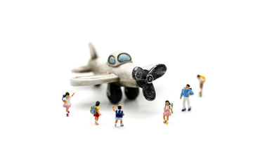 Miniature people : student and children with airplane,education and fun travel concept.