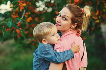 Family portrait of mother and son in nature .Mother's day
