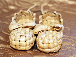 Old Russian sandals made of bark on a golden background