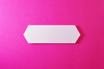 double arrow banner on pink background