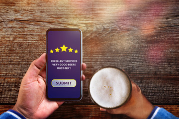 Customer Experience Concept. Man using Smartphone in Cafe or Restaurant to Feedback Five Star Rating in Online Satisfaction Survey Application, Food and Drink Review, Top View