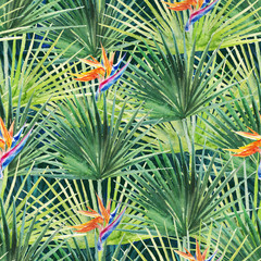 Green tropical palm & fern leaves and flowers on black background. Watercolor hand painted seamless pattern. Tropical illustration. Jungle foliage.
