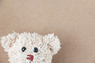 Cute teddy bear with brown paper background