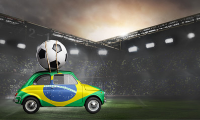 Brazil flag on car delivering soccer or football ball at stadium