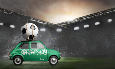 Saudi Arabia flag on car delivering soccer or football ball at stadium