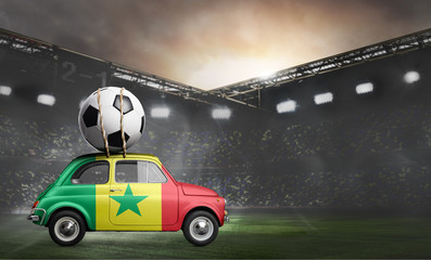 Senegal flag on car delivering soccer or football ball at stadium