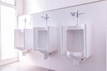 men toilet white unirals tiolet room.