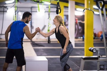 Keuken foto achterwand Fitness woman working out with personal trainer jumping on fit box