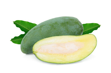 whole and half green mango with green leaves isolated on white background