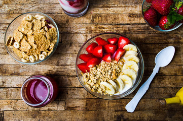 Breakfast cereals with banana and strawberry in bowls
