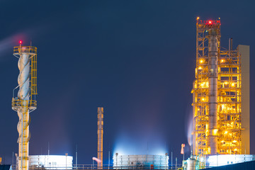 Oil and gas refinery plant area at twilight