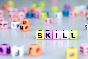 Skill word text written on colorful cube with bokeh cube word block background