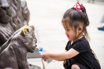 Little hospitality, Girl giving milk to animals