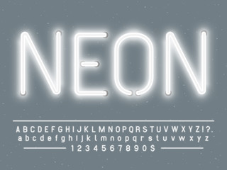 Bright glowing white neon sign characters. Vector font with glow light letters and numbers lamps Fotomurales