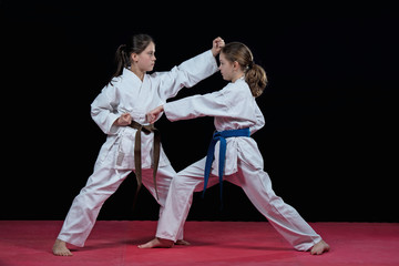 Children are training karate blows