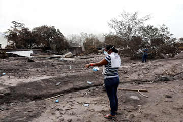 Eufemia Garcia, 48, who lost 50 members of her family during the eruption of the Fuego volcano, points the area where use to be her house in San Miguel Los Lotes
