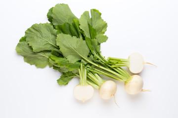 Fresh white round turnip radish on white background.
