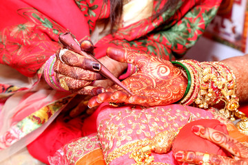 Application of henna as skin decoration in Indian Wedding, Wedding at the indian ceremony