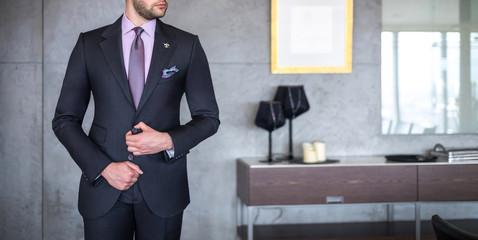 Man in custom tailored business suit posing indoors
