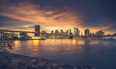 Wall Mural - New York City at sunset. NYC famous postcard place at Brooklyn Bridge park with Brooklyn Bridge in front of image.