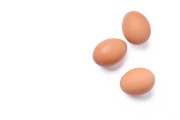 Top view of three raw eggs