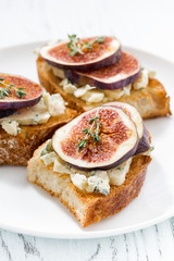 toast with figs and blue cheese, vertical closeup