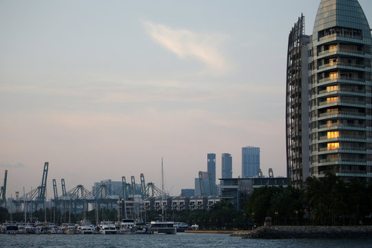 Sentosa Cove apartments are pictured next to luxury yachts in Singapore,