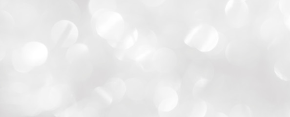 White background. Template for a Christmas greeting card with blurry shiny circles.