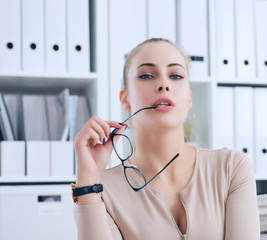 Fototapeta Sexy secretary with glasses in hand undresses in office, flirt and desire. Office provocation. obraz