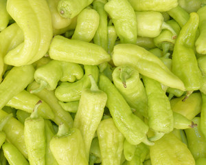 organic green peppers top view, food background