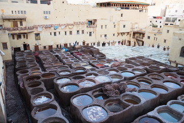 Local people painting leather at the tannery by the ancient way  in Morocco.