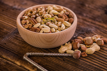 wooden bowl full of different muxture variety of nuts