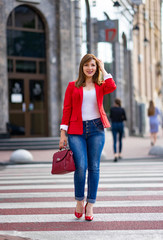 girl in the jacket goes on the pedestrian crossing