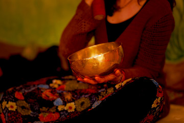 spiritual girl immersed in meditative sounds of tibetian bowl.