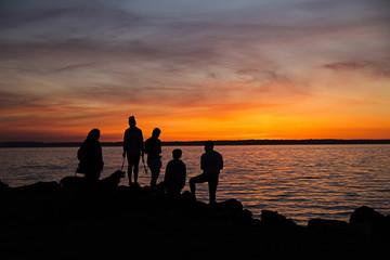 people enjoying a sunset